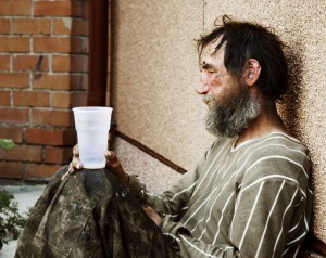 Homeless poor alcoholic in depression.